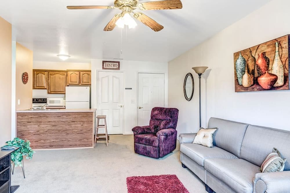 Cozy senior living apartment with arm chairs and ceiling fan at Brookstone Estates of Paris in Paris, Illinois