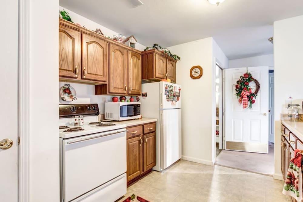 Kitchen of senior living apartment with wood accents at Brookstone Estates of Paris in Paris, Illinois