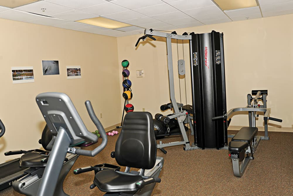 Get your workout in at the fitness center at Racquet Club Apartments