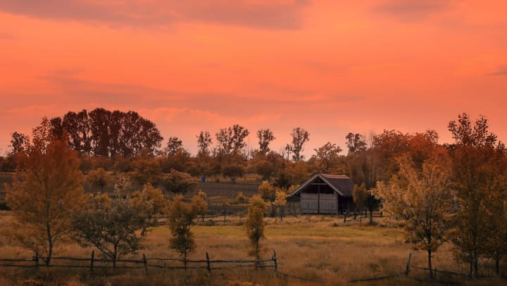 Sunset behind a historic ranch building near Sundance Creek in Midland, Texas