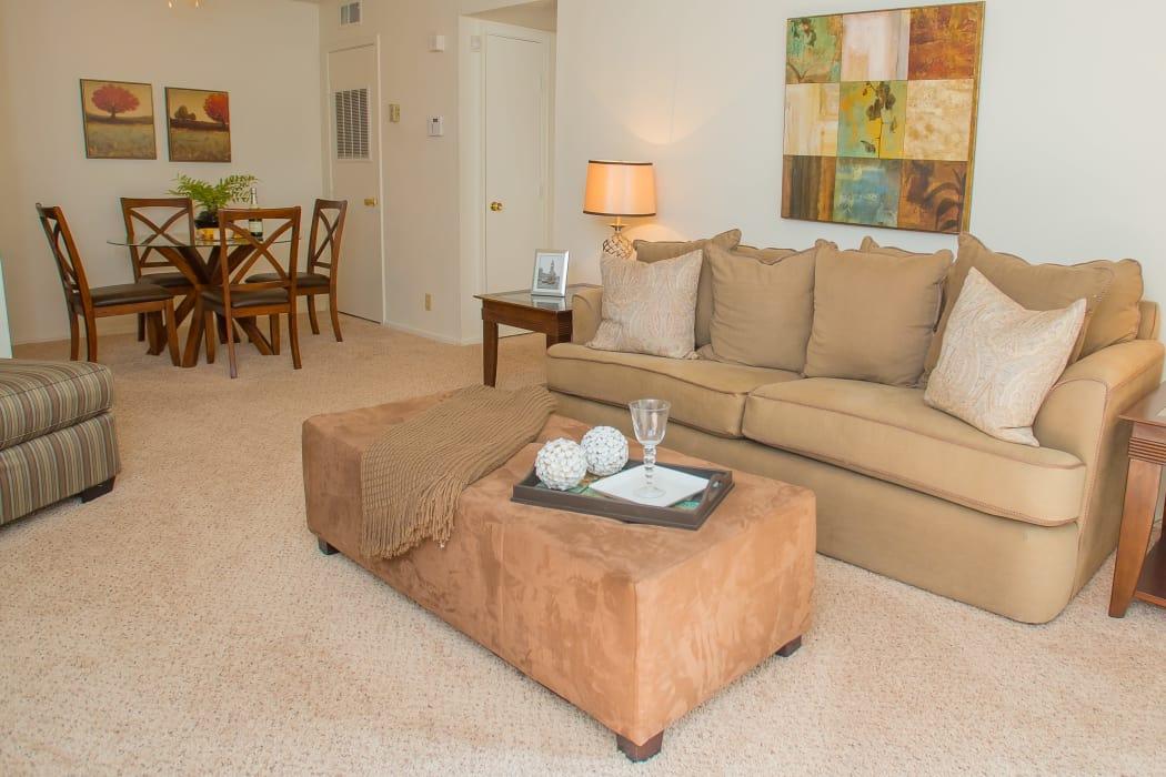 Bright living room at Riverpark Apartments in Tulsa, Oklahoma