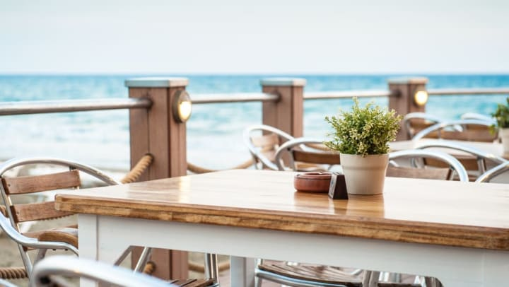 Breakfast tables overlooking the beach at Cape House Apartments in Jacksonville, Florida