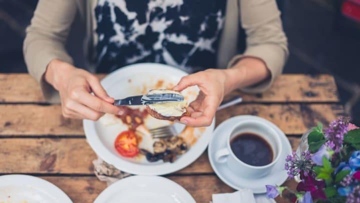 Woman preparing breakfast at a restaurant near Olympus Fenwick in Savannah, Georgia