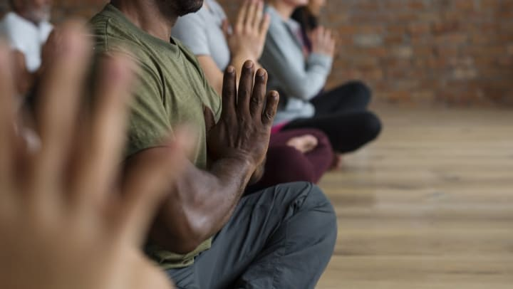 Students performing a yoga pose in a studio near Sedona Ranch in Odessa, Texas