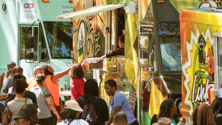 Line of food trucks near Cape House Apartments in Jacksonville, Florida