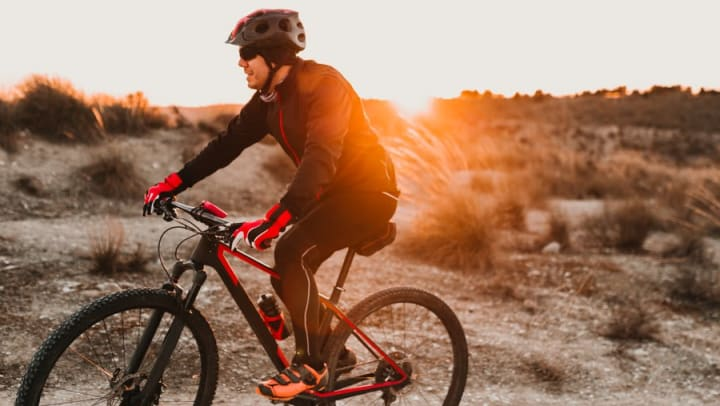 Early morning mountain biker near Olympus Katy Ranch in Katy, Texas