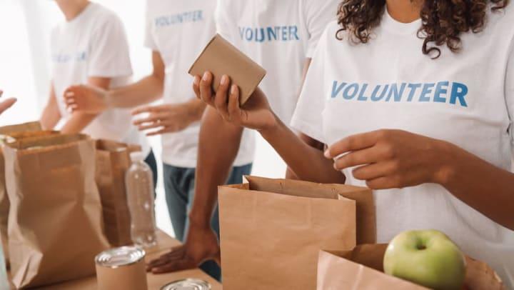 Volunteers bagging canned food near Olympus Encantata in Albuquerque, New Mexico