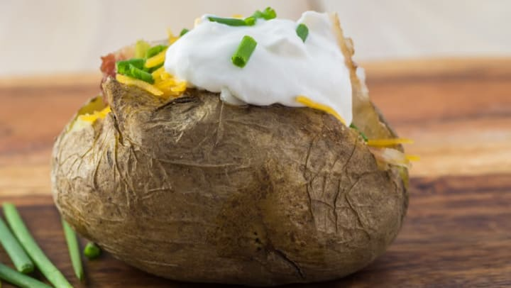 Stuffed baked potato with all the trimmings from a restaurant near Lux on Main in Carrollton, Texas