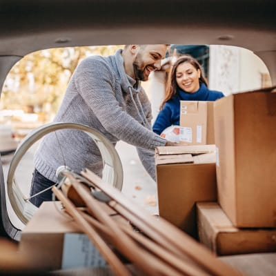 Couple unloading boxes from their car at A-American Self Storage in Hemet, California