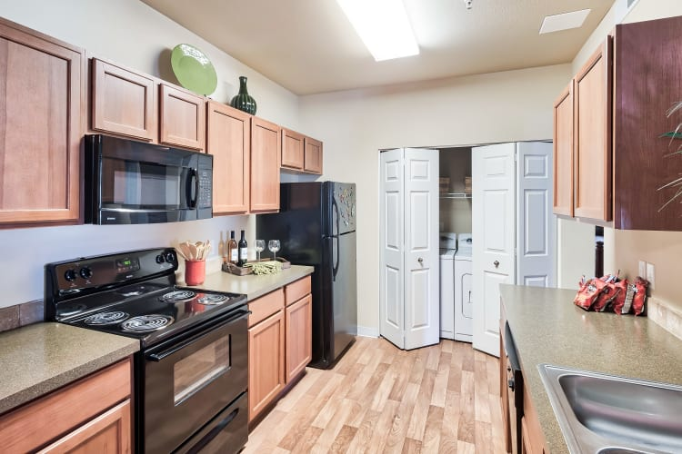 Model kitchen and washer/dryer at Selway Apartments