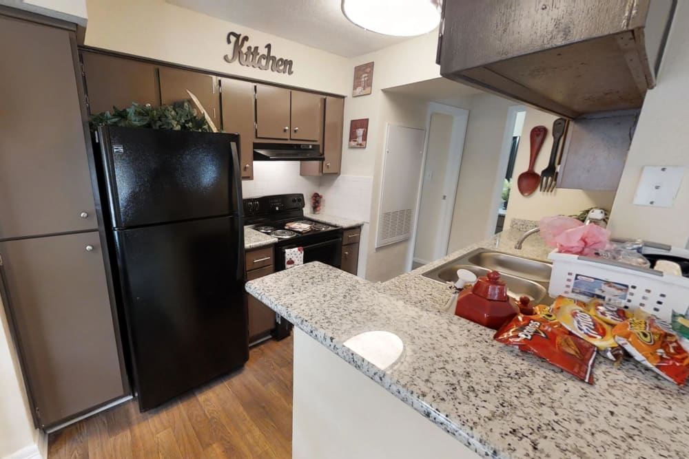 Dining and kitchen area at Cedar Ridge Apartments