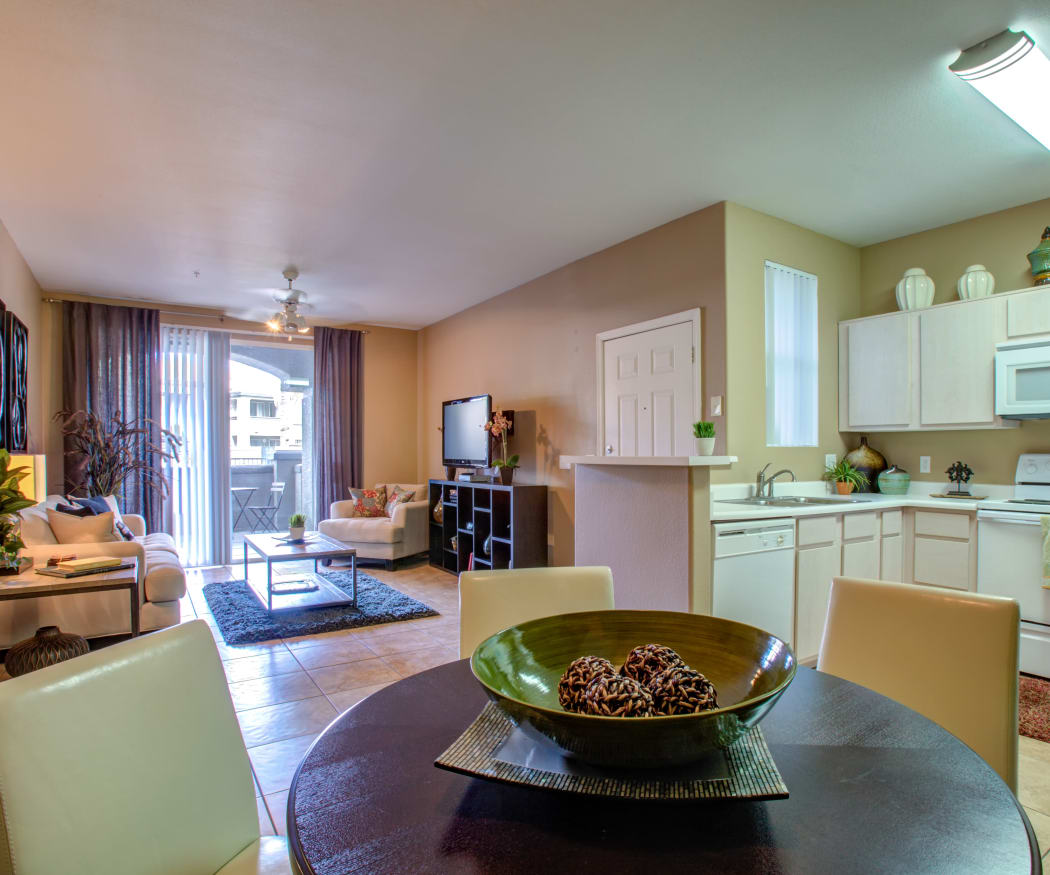 View of the living area and kitchen from a model home's dining room at Sierra Canyon in Glendale, Arizona