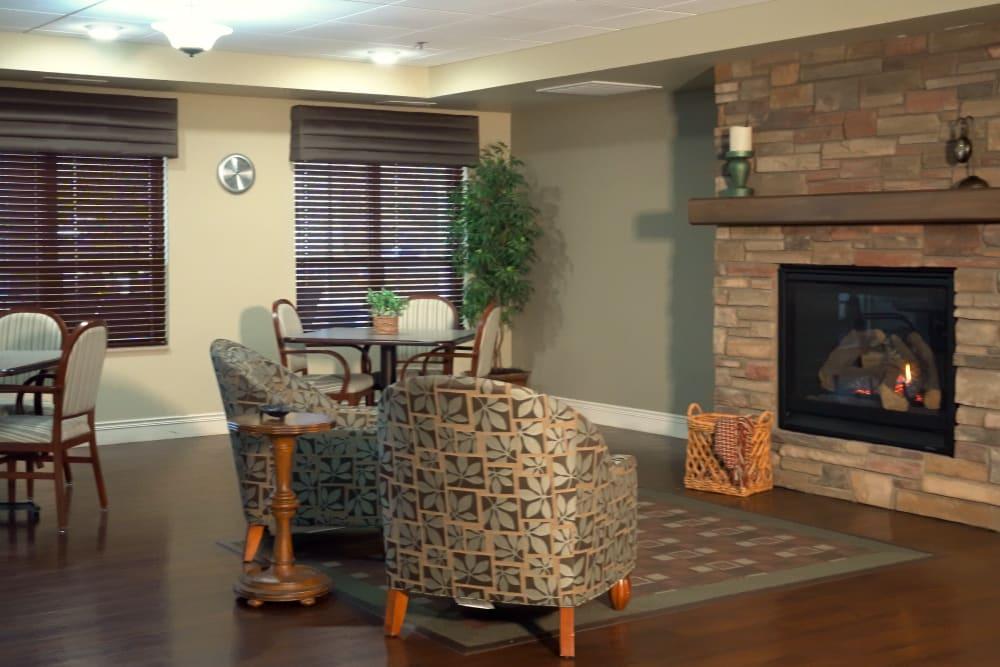 Fireplace Lounge seating inside Deephaven Woods in Deephaven, Minnesota