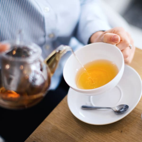 Pouring tea at The Crest at Citrus Heights in Citrus Heights, California.