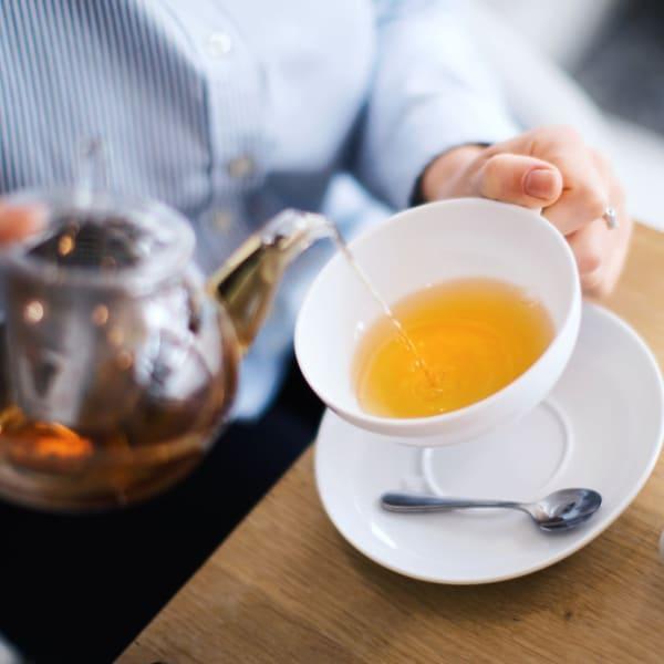 Pouring tea at Sellwood Senior Living in Portland, Oregon.