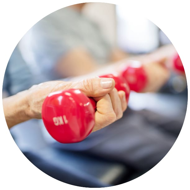 fitness class with residents lifting weights at a Ebenezer Senior Living community