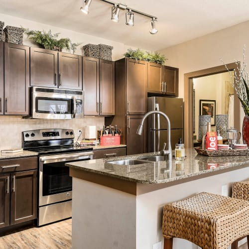 Sparkling stainless-steel appliances in a model home's kitchen at Sedona Ranch in Odessa, Texas