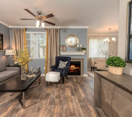 Spacious living room with wood-style flooring at The Artisan Apartment Homes in Sacramento, California