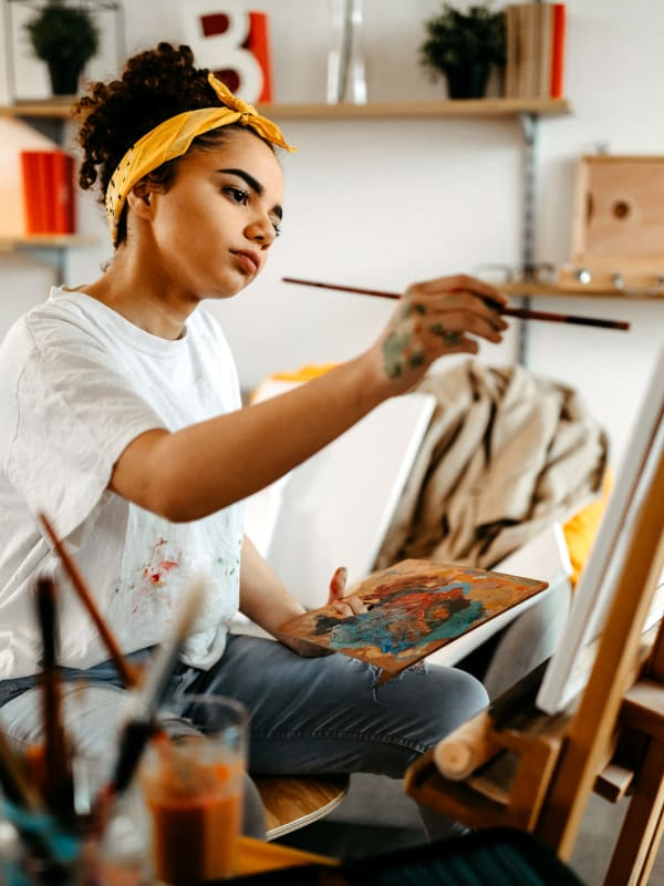 Woman painting at Bellrock Upper North in Haltom City, Texas