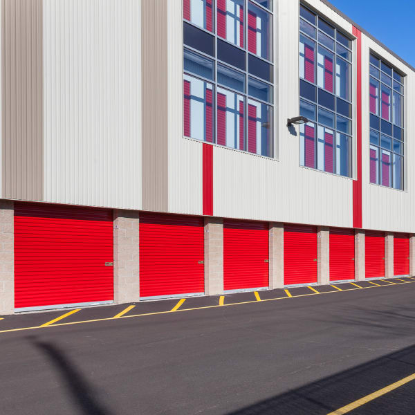 Exterior storage units with red doors at StorQuest Self Storage in Jersey City, New Jersey