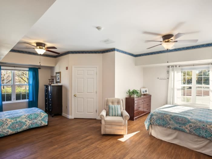 Enjoy a bedroom at Pacifica Senior Living Spring Valley senior living facility