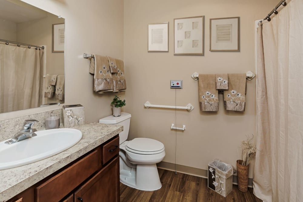 Spacious bathroom with hardwood floors in upscale senior living apartment at The Springs at Grand Park in Billings, Montana