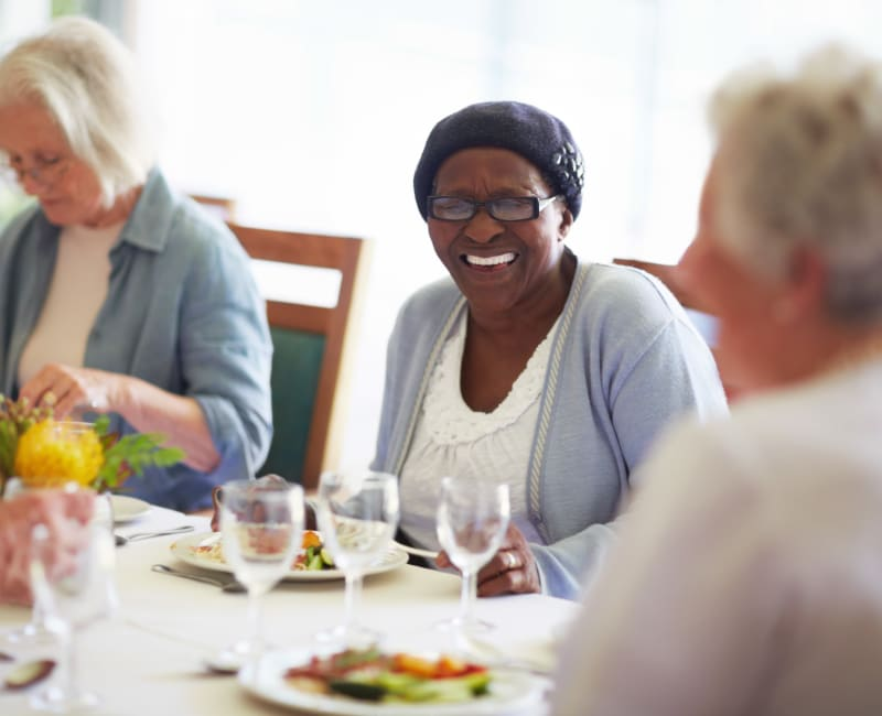 A woman dining with her friends at The Sanctuary at West St. Paul in West St. Paul, Minnesota