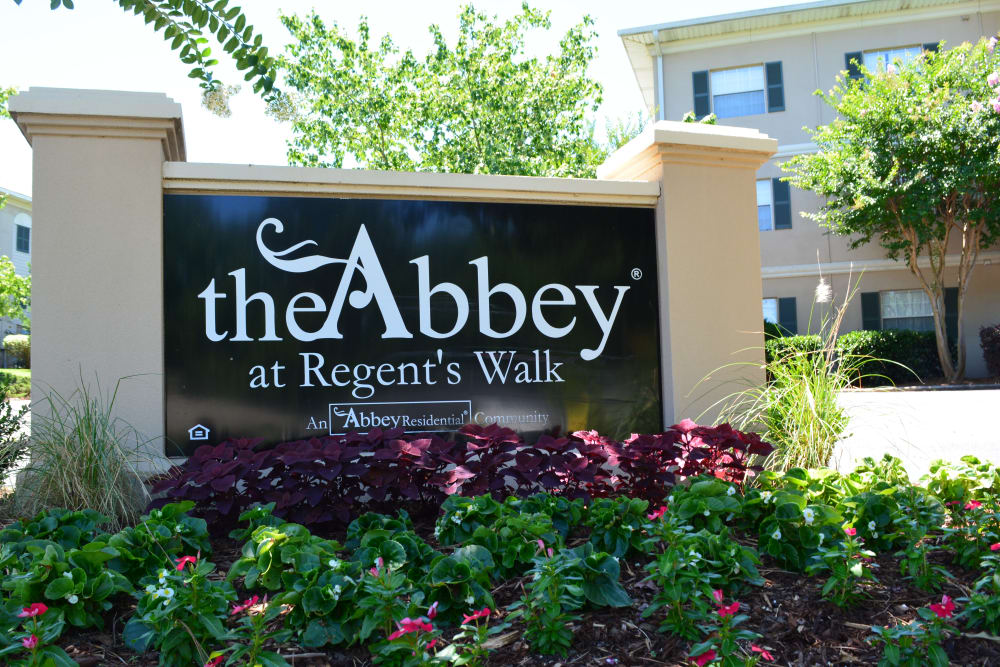 Landscaping in front of sign at The Abbey at Regent's Walk in Homewood, AL