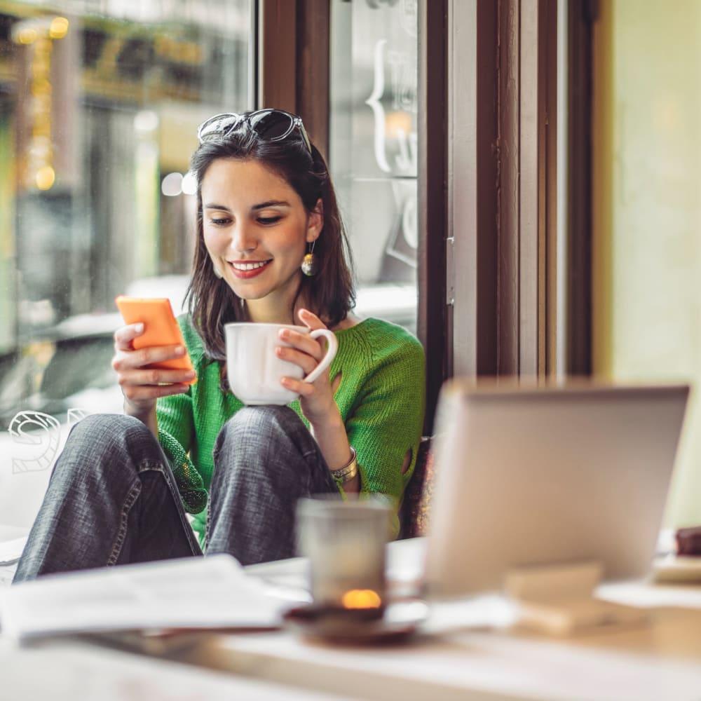 Woman working at a coffee shop near 401 Oberlin in Raleigh, North Carolina