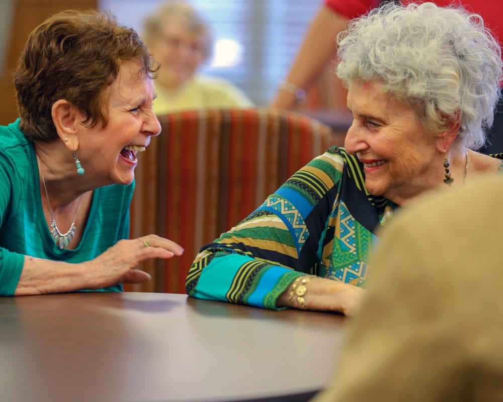 Residents laughing together at Harmony at Brookberry Farm in Winston-Salem, North Carolina