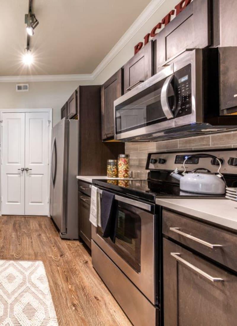 Modern kitchen with sleek appliances at Marquis on Memorial in Houston, Texas
