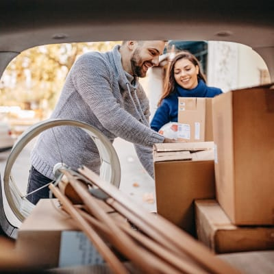Couple unloading boxes from their car at AAA Self Storage, LLC in Chatsworth, California