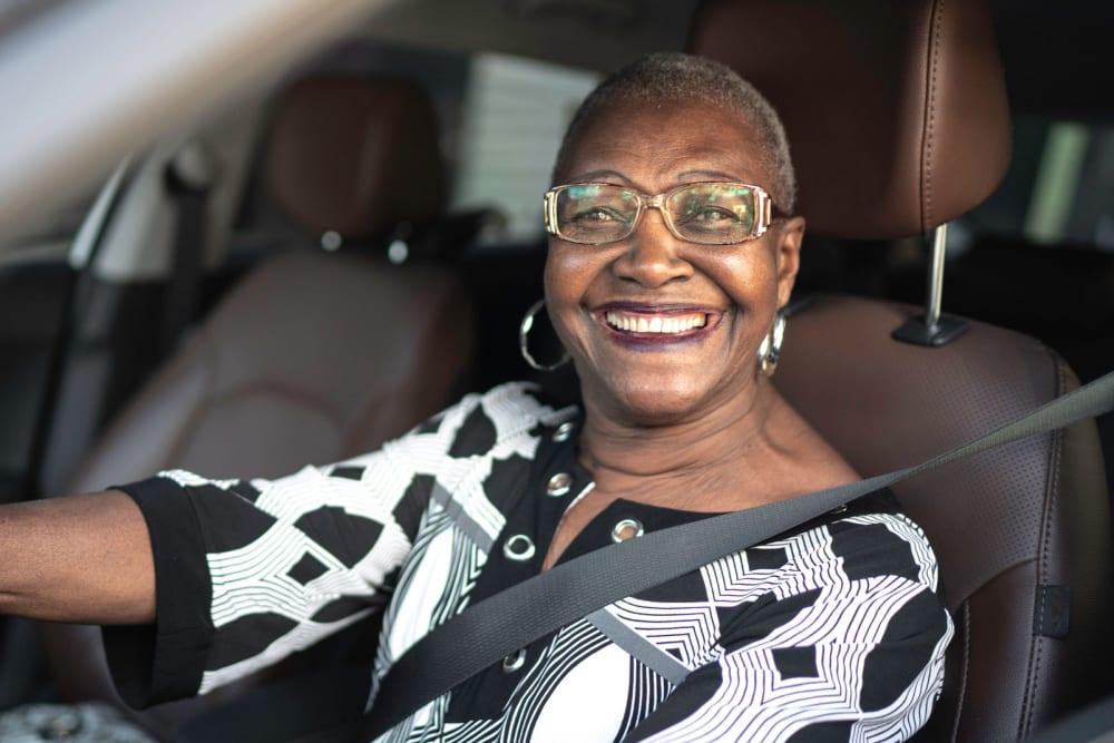 Resident sitting in her car at Winding Commons Senior Living in Carmichael, California