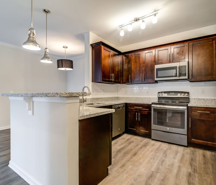 Modern kitchen with stainless-steel appliances in model home at Richland Falls in Murfreesboro, Tennessee