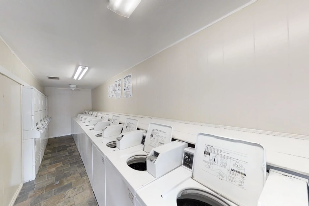 Renovated laundry facility at Falls of Maplewood Apartments in Houston, Texas