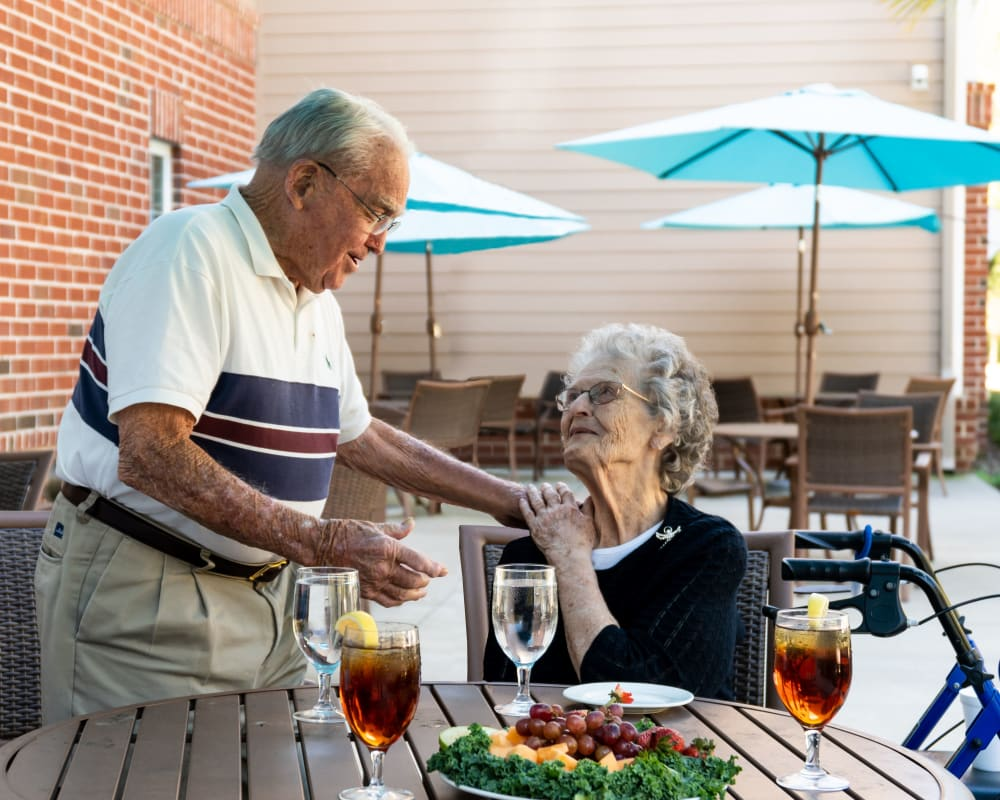 Two residents share a conversation at Harmony at Waldorf in Waldorf, Maryland
