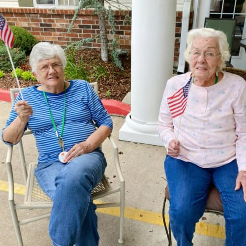Two residents with flags at Canoe Brook Assisted Living in Broken Arrow, Oklahoma