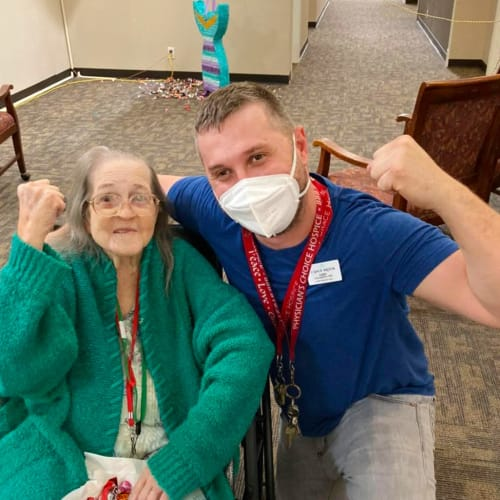 Resident with team member showing strength at Canoe Brook Assisted Living in Broken Arrow, Oklahoma