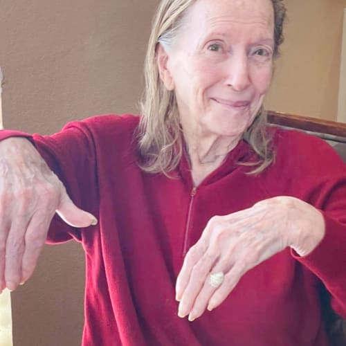 Resident showing her nails at Oxford Glen Memory Care at Sachse in Sachse, Texas