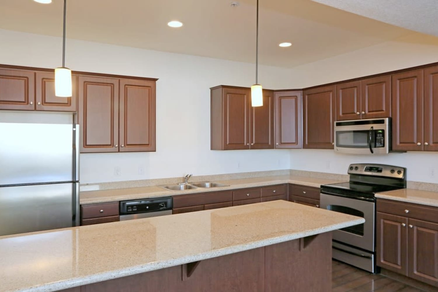 Kitchen with wooden cabinetry at San Marquis in Tempe, Arizona