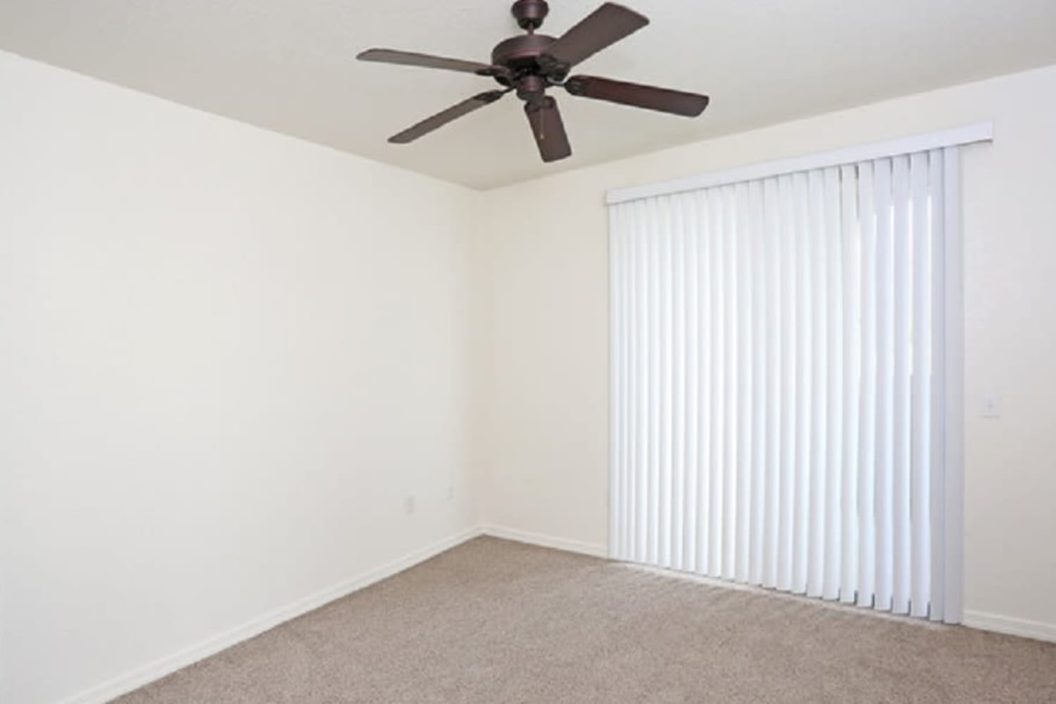 Naturally lit room with a ceiling fan at San Marquis in Tempe, Arizona
