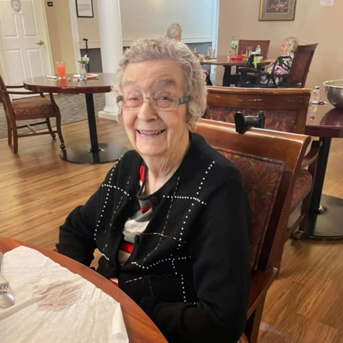 Happy resident at dinner at Canoe Brook Assisted Living in Broken Arrow, Oklahoma