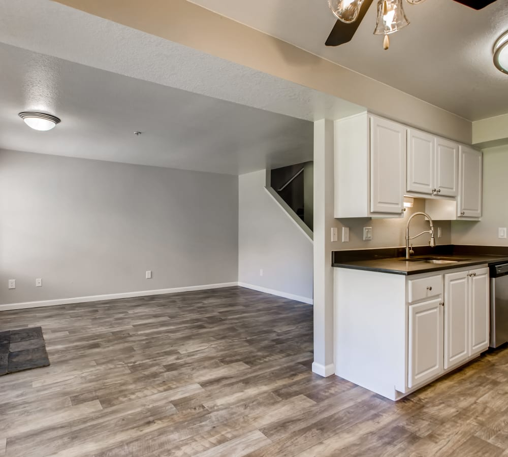 Kitchen with wood-style flooring in a townhouse at Slate Ridge at Fisher's Landing Apartment Homes in Vancouver, Washington