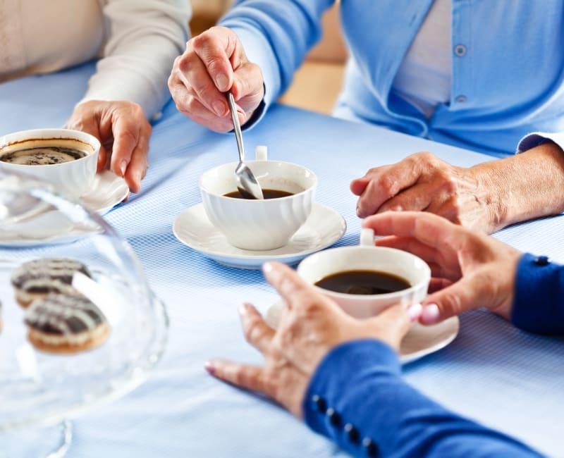 Resident enjoying coffee and pastries at Arbor Glen Senior Living in Lake Elmo, Minnesota