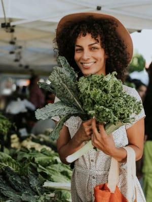 A women enjoying shopping at the farmer's market near Haven Hills in Vancouver, Washington