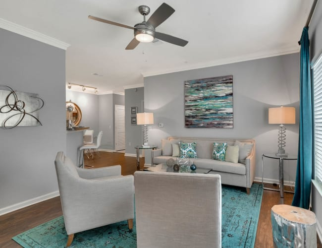 Well decorated model living room at Palms at World Gateway in Orlando, Florida
