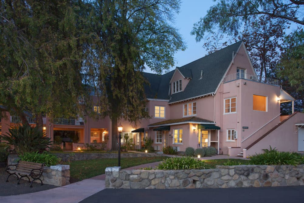 The building exterior of Gables of Ojai in Ojai, California at dusk