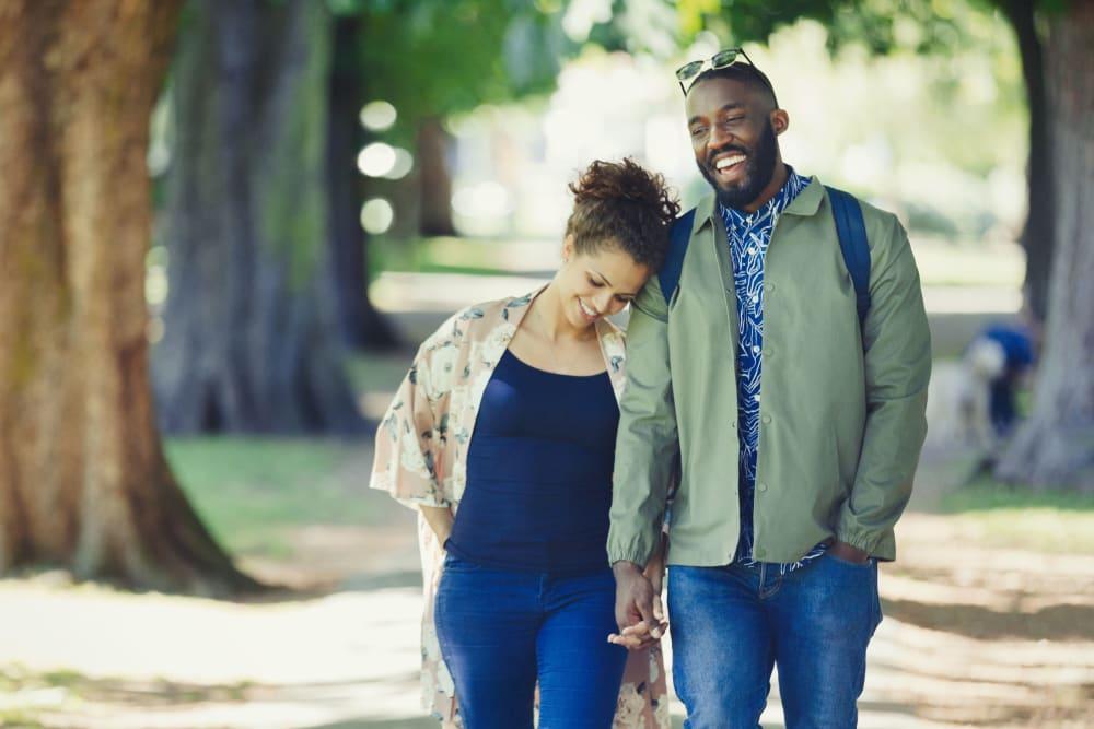 Couple walking through a local park in Edina, Minnesota near Oaks Lincoln Apartments & Townhomes