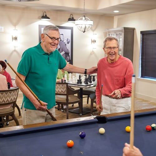 Residents playing pool in the game room at The Crossings at Eastchase in Montgomery, Alabama
