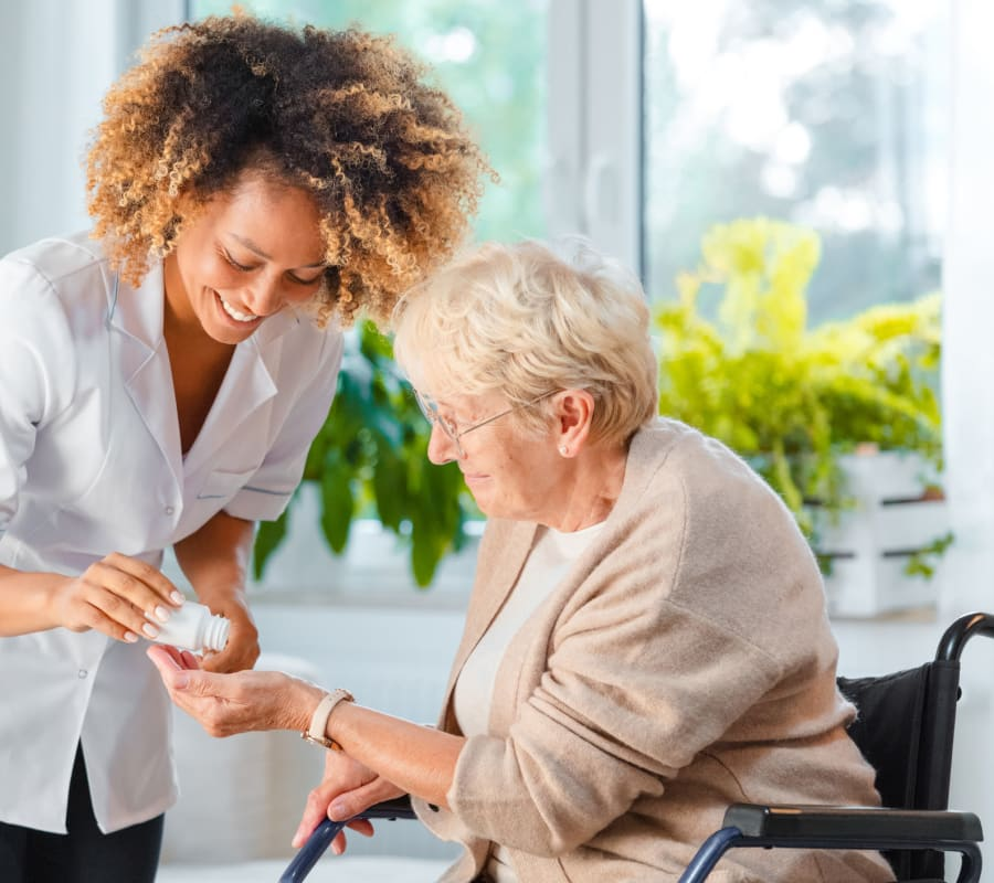 Resident receiving medication at Farmington Square Gresham in Gresham, Oregon